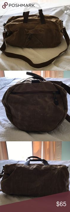 J. Crew Abington Duffle Bag It actually can fit a decent amount of stuff inside. It has one pocket on the front, and one on each side. I received the bag in the mail and it came with the marks on it, I think it's just the material maybe to make it look more vintage? Idk? It has leather handles on top and also a detachable long strap. Super functional! This is technically a men's bag but I'm posting it in women's because do men actually use this app? LOL.   P.s. offers welcome J. Crew Bags