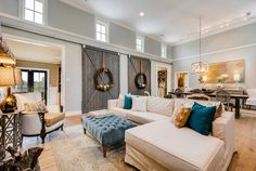 Fixer Upper style family room with barn doors. Paint color is Restoration Hardware Silver Sage.  Van Wicklen Design.  Travis Wayne Baker Photography.