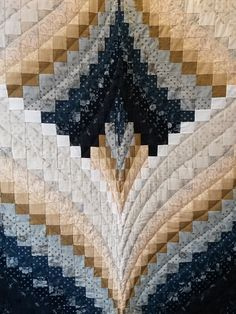 This beautiful Queen size quilt measures 98″ x 112″. It is a Bargello pattern featuring tan, blue and black fabrics and was hand quilted by a local Amish woman.