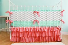 Make a crib skirt.  I love these colors, pinks, reds, light teal and yellow/gold would be a nice color scheme, feminine and vintage but not all Barbie pink and obnoxious!