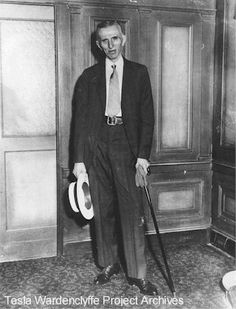 Nikola Tesla standing next to his suite at the Hotel New Yorker - circa 1934