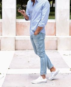 Light blue vertical striped shirt, light blue jeans, white sneakers