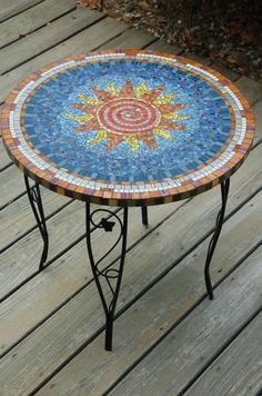 Mosaic on glass top of garden table.