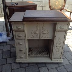 Gorgeous antique sewing cabinet that has been gutted for use as a f...