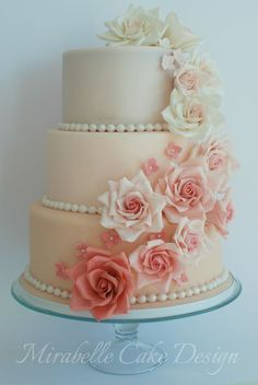 Red velvet cake in shades of pink with gum paste roses