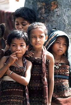 Girls from the village of Ili Ape on Lembata wearing traditional ikat sarongs
