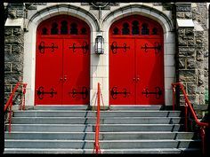 double red doors with stone surrounds