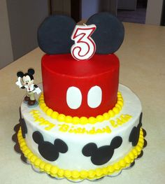 Mickey Mouse cake. Buttercream cake with fondant accents.