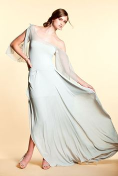 Contessa Gown by Lilly Lorraine Inc. Draping blue-grey silhouette gown with sheer mesh neckline and draping open tie sleeves.