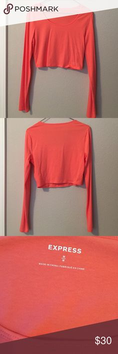 Coral Orange Express Long Sleeve Crop Top This soft, cotton crop top is perfect for any occasion. Never been worn. Bright coral orange. From Express Express Tops Crop Tops