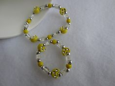 18 in doll bracelet, 18 in doll jewelry, Stretch bracelet set for 18 inch doll and girl. Yellow beads, silver beads, beaded doll bracelet by SuesStashBuster on Etsy