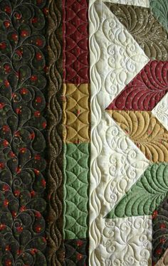 Love the border quilting on this carpenter's star