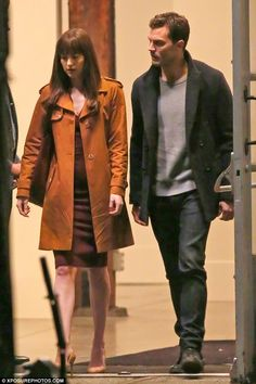 Under wraps: Both actors were dressed in a reserved manner, with Dakota - who stars as virginal student turned contracted submissive, Anastasia Steele - covered up in a stylish tan coat worn over a plum dress