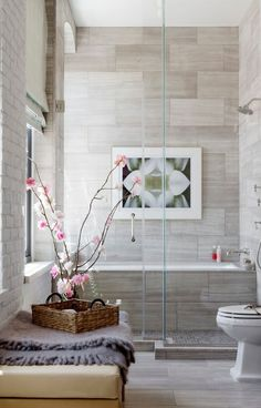 Contemporary bathroom ideas marble tile shower glass doors wall art
