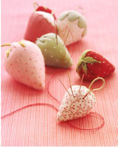 Strawberry pincushion tutorial  http://felting.craftgossip.com/2012/04/16/strawberry-pincushion-tutorial/