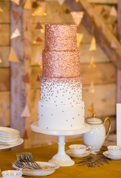 Brides.com: 29 Glam Metallic Wedding Cakes. A four-tiered wedding cake with shimmering bronze details, from City View Bakehouse.