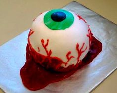 Halloween Cake  This so reminds me of the time my mother lost an eye to infection and we had a party with an eyeball cake my Aunt Trevah made.