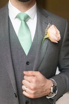peach buttonhole mint green tie groom. See more of our floral designs and wedding styling at www.passionforflowers.net. Voted Best Wedding Florist in ENGLAND in The Wedding Industry Awards.