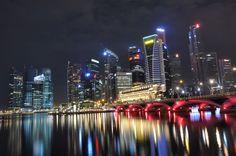 Singapore skyline and bridge at night by kewl, via Flickr