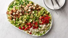 Ever feel torn between ordering a salad or splurging on a more indulgent appetizer? No need to choose when you can have this grilled guacamole and chopped chicken salad combo!