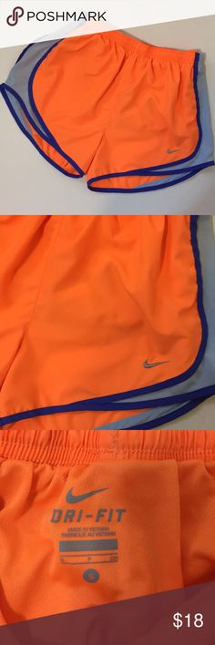 Nine Dri-Fit Drawstring Waist Running Shorts Neon orange running shorts with blue trim and gray sides. Drawstring waist. Gently worn. Nike Shorts