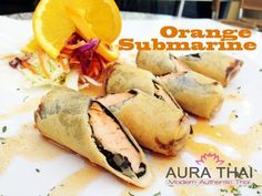 Orange Submarine Marinated Salmon Wred In Seaweed And Egg Roll Skin Deep Fried To Golden Brown Served With Sweet N Sour Sauce Aura Thai Food