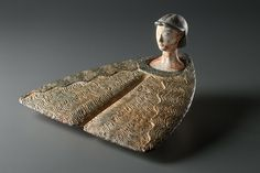 Bactrian composite flat idol, late 3rd millennium B.C. This work can be compared to the most beautiful Bactrian figures for both its artistic and its technical qualities, carved from two stones of different color, 11.2 cm long. Private collection
