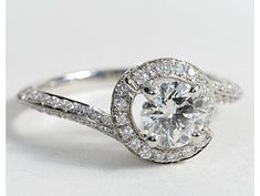 spiral engagement ring- so cute and different but I wish the posts around the ring weren't there
