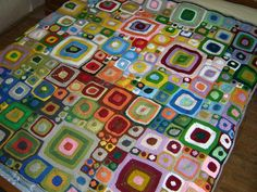 Clara's blanket by Clarablog. Love the colours and different sized squares. Would like to do some stitching like this!