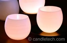 Balloon Luminaries  http://www.candletech.com/techniques-and-ideas/water-balloon-luminaries/