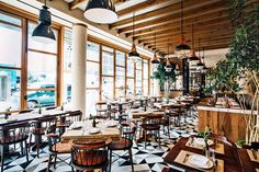 "A bold geometric floor takes center stage in this rustic-chic Italian restaurant designed by Brooklyn-based firm Crème. ""I've taken my memories of meals with family and friends and re-created the experience in Chelsea,"" chef Laurent Tourondel told AD in November. Exposed beams and floor-to-ceiling windows add to the charm of the space. 849 Avenue of the Americas, New York; lamico.nyc"