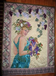 Jennifer Wheatley-Wolf,   My 'Harvest' quilt was inspired by 'Le Fruit' by my favorite Art Nouveau artist, Alphonse Mucha. I used Mucha Postcards clip art.