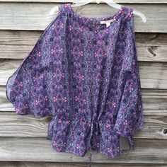 Sheer flutter sleeve top. NWT Pretty purple top with flutter sleeves. Drawstring waist. Button at keyhole opening in back.  NWT Forever 21 Tops