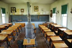 """An old one room schoolhouse, restored at Stuhr Museum of the Prairie Pioneer in Grand Island, Nebraska. I remember having a field trip to this and having """"school"""" like they use to!"""