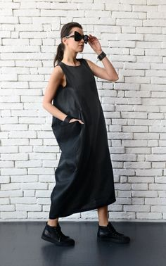 Plus size black linen dress - METD0075 Gorgeous maxi dress made in high quality linen fabric that is a piece that could be worn by anybody. It has front accent pockets that look interesting and are also practical. The dress is closed with a zipper on the back and has a statement slit. Not only this, but this oversize dress is super comfortable to wear which makes it a perfect day or work dress.  This dress is made out of 100% linen.  Find it in BEIGE here: https://www.etsy.com/...