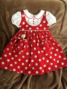 Darling Details ❤~ Piping, pin tucks, pockets and polka dots on dress from Dragonbees. Red and White Polka Dots Dress with Pocket Kitty Kids Dress Wear, Little Girl Dresses, White Polka Dot Dress, Polka Dots, Baby Dress Design, Baby Girl Dress Patterns, Baby Frocks Designs, Kids Frocks, Toddler Dress