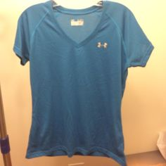 Under Armour short sleeve v-neck semi fitted shirt Under Armour short sleeve v-neck semi fitted shirt. Size M. Nothing wrong it with. Worn once but I prefer tank tops for running. Under Armour Tops