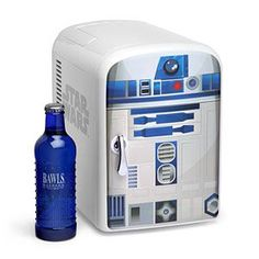 Meet the R2-D2 Mini Fridge. It features a warm and a cool setting for keeping your food just the right temperature. With its single shelf removed, this little R2 unit holds a 6-pack of 12-ounce cans.