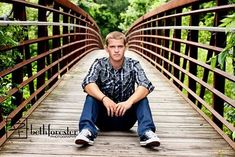 senior photo for butler on swinging bridge