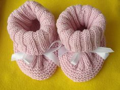 This is just a good recipe containing a photo tutorial. These booties will not fall away from your baby's feet. And they are knitted bottom up as one piece without yarn cut.