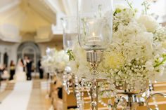 White hydrangeas and baby's breath ceremony floral decor with crystals at Disney's Wedding Pavilion