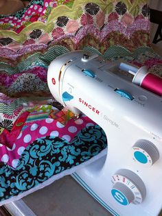 Bright, modern, and cute quilt using polka dots, chevron, and bold patterned fabrics! DIY