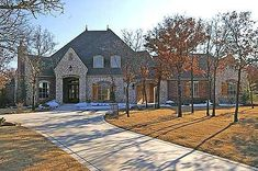 Plan W9613HG: French Country, Corner Lot, Premium Collection, Luxury, European, Photo Gallery House Plans & Home Designs