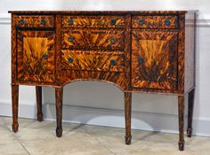 Mid-Century Hollywood Regency Faux Tortoiseshell Painted Classic Sideboard | From a unique collection of antique and modern sideboards at https://www.1stdibs.com/furniture/storage-case-pieces/sideboards/