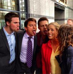 Stephen Amell, John Barrowman, Colton Haynes and Willa Holland joke around with co-star Emily Bett Rickards.