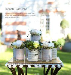 フレンチグラスポット ・・・・・ リアルな紙の質感をプリントした防水加工のラベル付グラス。ラベルのデザインは計2タイプ。プロヴァンス地方や地中海沿岸の旅の思い出をつづった日記をイメージした「ボヤージュ」。パリの街並みが絵葉書調に描かれた「カルテ」。どちらもフランスにゆかりのある器になっており、同じくフランス生まれのプリザーブドフラワーとの相性は群を抜いています。