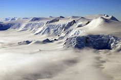 Strangely Moving Antarctic Lakes Surprise Researchers - Live Science. Pictured: Clouds drape mountains on Alexander Island. The topography creates many lakes on the George VI ice shelf. Credit: Michael Studinger/NASA