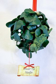 "Putting a ""Beware The Nargles"" sign is a cute way to lighten up an awkward mistletoe decoration. -SvH"