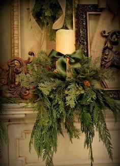 Lovely candles draped in greens.