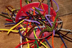 a fine motor activity - sticking pipe cleaners through holes in a colander. Holds a preschooler attention for quite some time! And teaches fine motor skills. Motor Skills Activities, Gross Motor Skills, Toddler Activities, Activities For Kids, Kindergarten Activities, Indoor Activities, Projects For Kids, Crafts For Kids, Classroom Projects